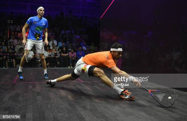 Mohamed Elshorbagy of Egypt and Ali Farag of Egypt compete during the men's final match of the PSA Dubai World Series Finals 2018 at Emirates Golf...