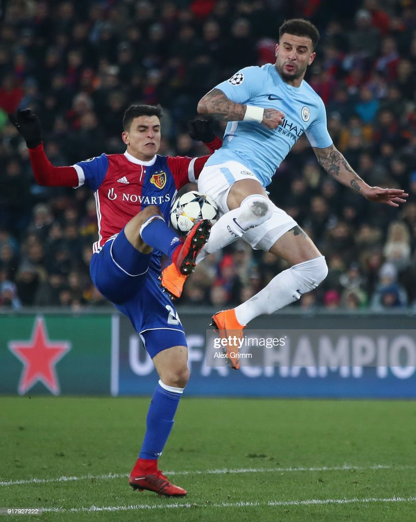 Mohamed Elyounoussi of Basel is challenged by Kyle Walker of Manchester during the UEFA Champions League Round of 16 First Leg match between FC Basel and Manchester City at St. Jakob-Park on February 13, 2018 in Basel, Switzerland.