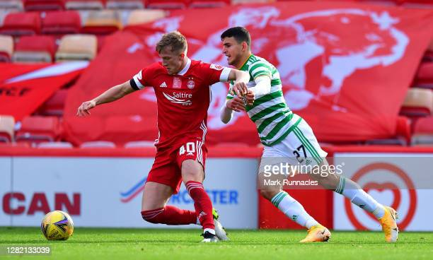 Mohamed Elyounoussi of Celtic and Ross McCrorie of Aberdeen battle for the ball during the Ladbrokes Scottish Premiership match between Aberdeen and...