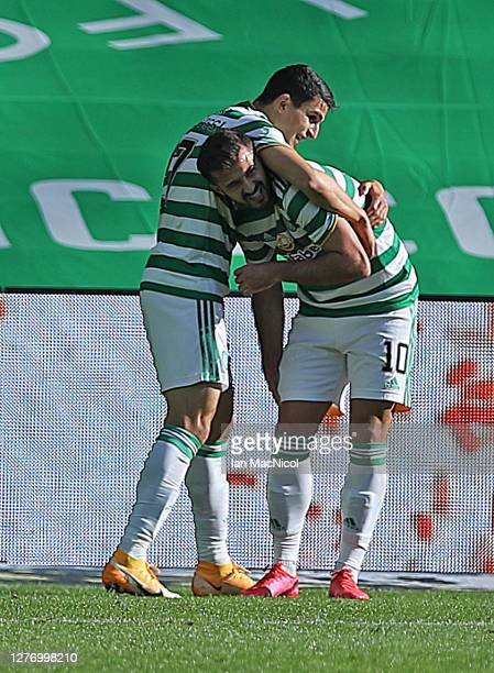 Mohamed Elyounoussi of Celtic congratulates Albain Ajeti after he scores his team's second goal during the Ladbrokes Scottish Premiership match...