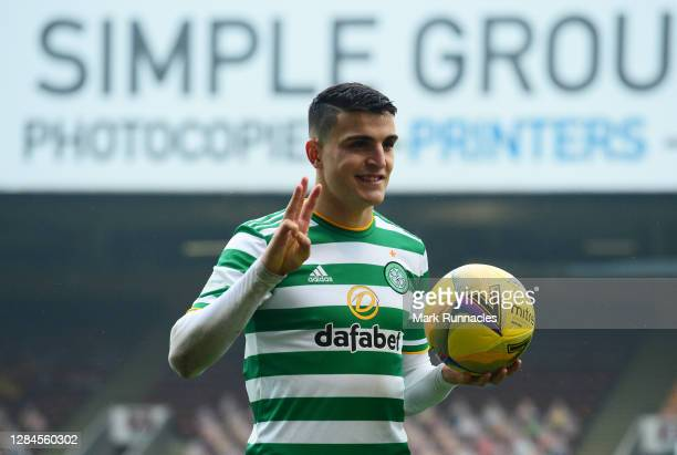 Mohamed Elyounoussi of Celtic holds the match ball after scoring a hattrick during the Ladbrokes Scottish Premiership match between Motherwell and...