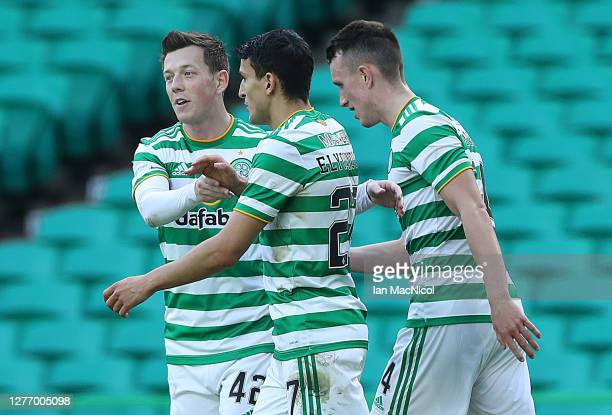 Mohamed Elyounoussi of Celtic is congratulated by Calum McGregor after scoring his sides third goal during the Ladbrokes Scottish Premiership match...