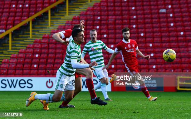 Mohamed Elyounoussi of Celtic is tackled by Tommie Hoban of Aberdeen leading to a penalty awarded to Celtic during the Ladbrokes Scottish Premiership...