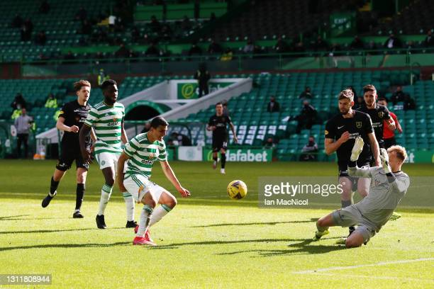 Mohamed Elyounoussi of Celtic scores their team's fifth goal past Robbie McCronie of Livingston during the Ladbrokes Scottish Premiership match...