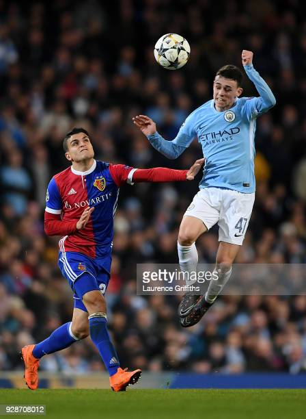 Mohamed Elyounoussi of FC Basel and Phil Foden of Manchester City battle for possession during the UEFA Champions League Round of 16 Second Leg match...