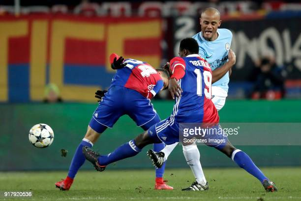 Mohamed Elyounoussi of FC Basel Dimitri Oberlin of FC Basel Vincent Kompany of Manchester City during the UEFA Champions League match between Fc...