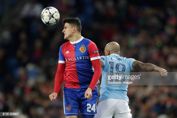 Mohamed Elyounoussi of FC Basel Fabian Delph of Manchester City during the UEFA Champions League match between Fc Basel v Manchester City at the St...