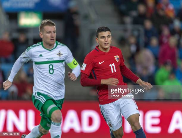 Mohamed Elyounoussi of Norway Steven Davis of Northern Ireland during the FIFA 2018 World Cup Qualifier between Norway and Northern Ireland at...