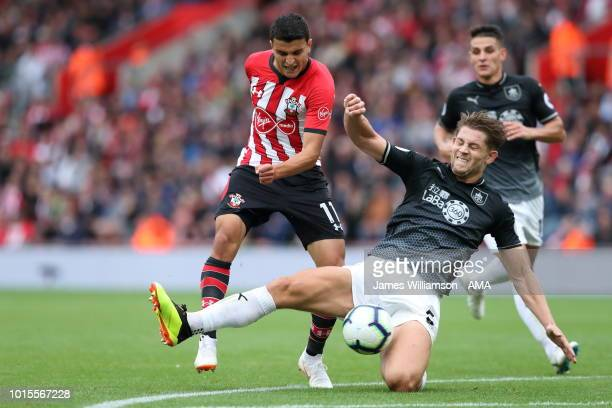 Mohamed Elyounoussi of Southampton has a shot blocked by James Tarkowski of Burnley during the Premier League match between Southampton FC and...