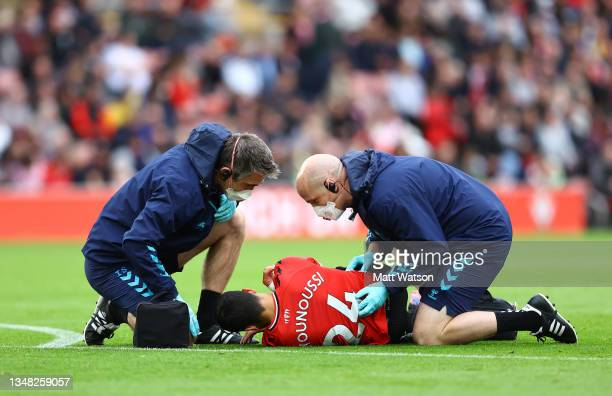 Mohamed Elyounoussi of Southampton is treated by the medical team during the Premier League match between Southampton and Burnley at St Mary's...