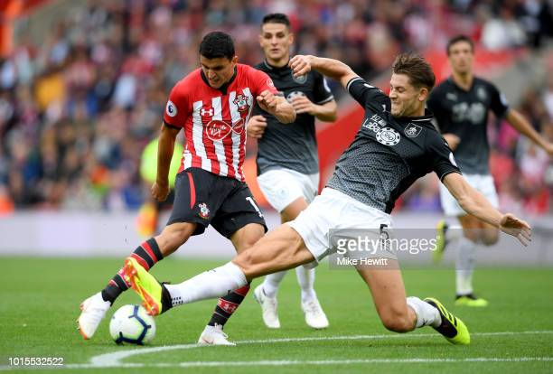 Mohamed Elyounoussi of Southampton shoots under pressure from James Tarkowski of Burnley during the Premier League match between Southampton FC and...