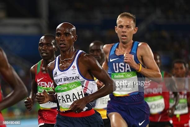 Mohamed Farah of Great Britain and Galen Rupp of the United States compete in the Men's 10000m on Day 8 of the Rio 2016 Olympic Games at the Olympic...
