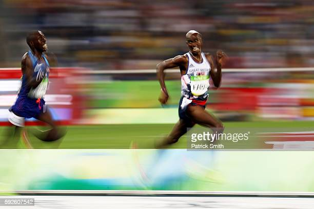 Mohamed Farah of Great Britain and Paul Kipkemoi Chelimo of the United States compete during the Men's 5000 meter on Day 15 of the Rio 2016 Olympic...