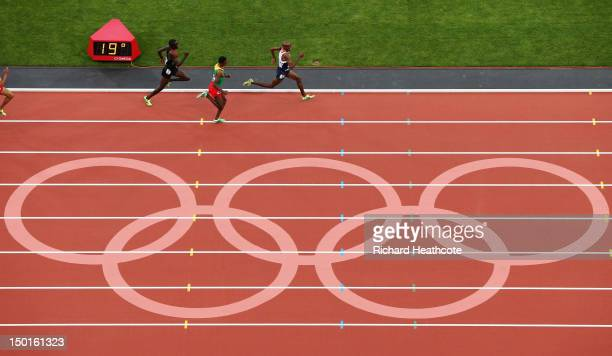 Mohamed Farah of Great Britain approaches the finish line ahead of Dejen Gebremeskel of Ethiopia and Thomas Pkemei Longosiwa of Kenya as they compete...