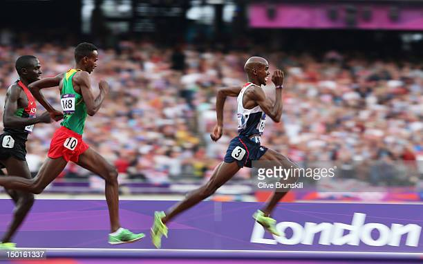 Mohamed Farah of Great Britain approaches the finish line on his way to winning gold ahead of Dejen Gebremeskel of Ethiopia and Thomas Pkemei...