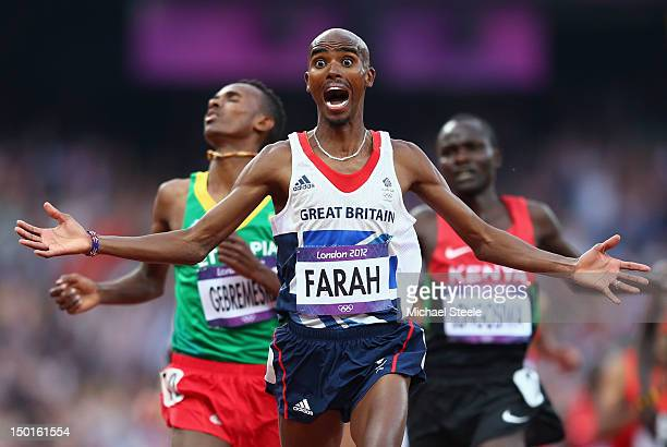 Mohamed Farah of Great Britain celebates as he crosses the finish line to win gold ahead of Dejen Gebremeskel of Ethiopia and Thomas Pkemei Longosiwa...