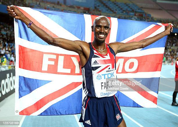 Mohamed Farah of Great Britain celebrates after claiming victory in the men's 5000 metres final during day nine of 13th IAAF World Athletics...