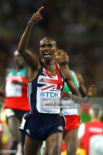 Mohamed Farah of Great Britain celebrates as he crosses the finish line to claim victory in the men's 5000 metres final during day nine of 13th IAAF...