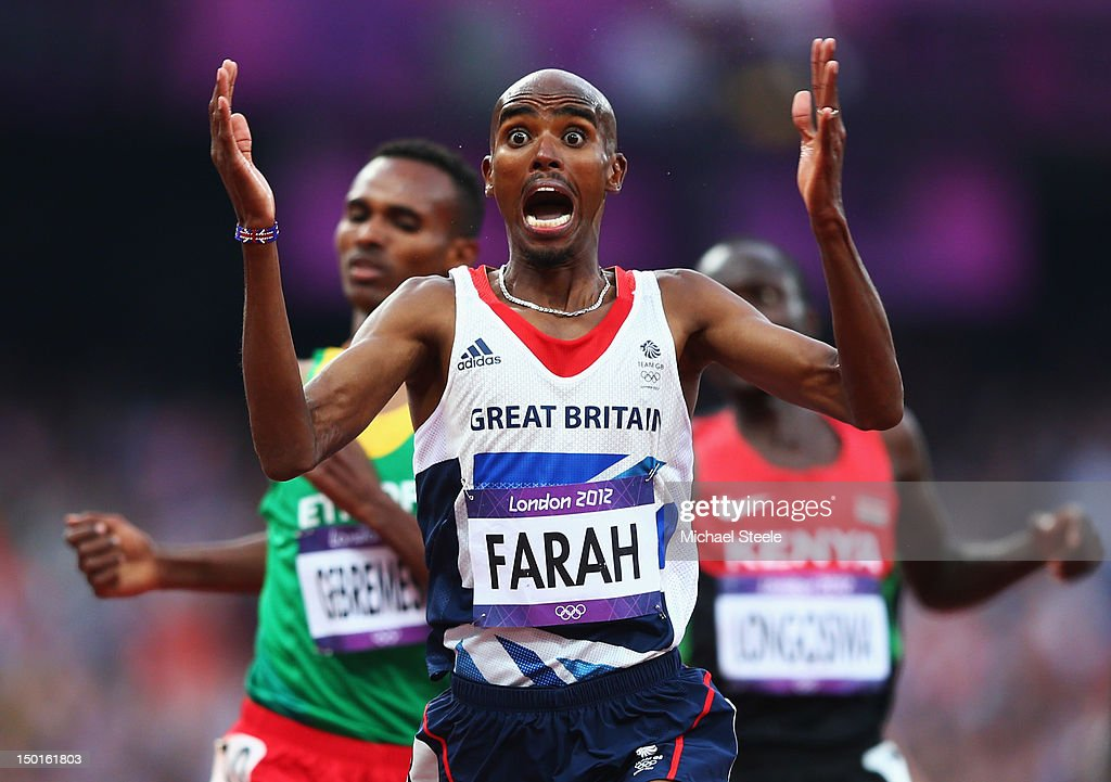 Mohamed Farah of Great Britain celebrates as he crosses the finish line to win gold ahead of Dejen Gebremeskel of Ethiopia and Thomas Pkemei Longosiwa of Kenya in the Men's 5000m Final on Day 15 of the London 2012 Olympic Games at Olympic Stadium on August 11, 2012 in London, England.