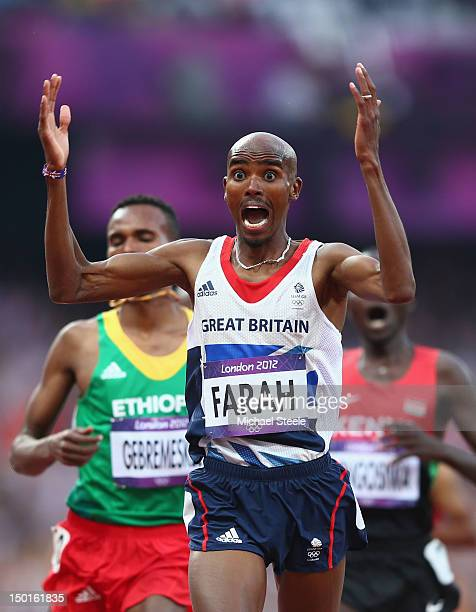 Mohamed Farah of Great Britain celebrates as he crosses the finish line to win gold ahead of Dejen Gebremeskel of Ethiopia and Thomas Pkemei...