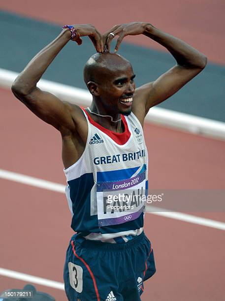 Mohamed Farah of Great Britain celebrates victory in the Men's 5000m Final on Day 15 of the London 2012 Olympic Games at Olympic Stadium on August...