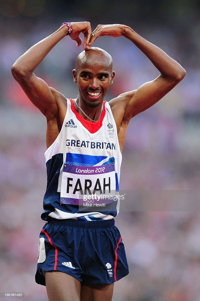 Mohamed Farah of Great Britain celebrates winning gold in the Men's 5000m Final on Day 15 of the London 2012 Olympic Games at Olympic Stadium on August 11, 2012 in London, England.