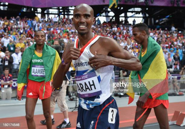 Mohamed Farah of Great Britain celebrates winning gold in the Men's 5000m Final on Day 15 of the London 2012 Olympic Games at Olympic Stadium on...