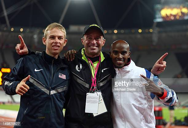 Mohamed Farah of Great Britain celebrates winning gold with silver medalist Galen Rupp of the United States and coach Alberto Salazar after the Men's...