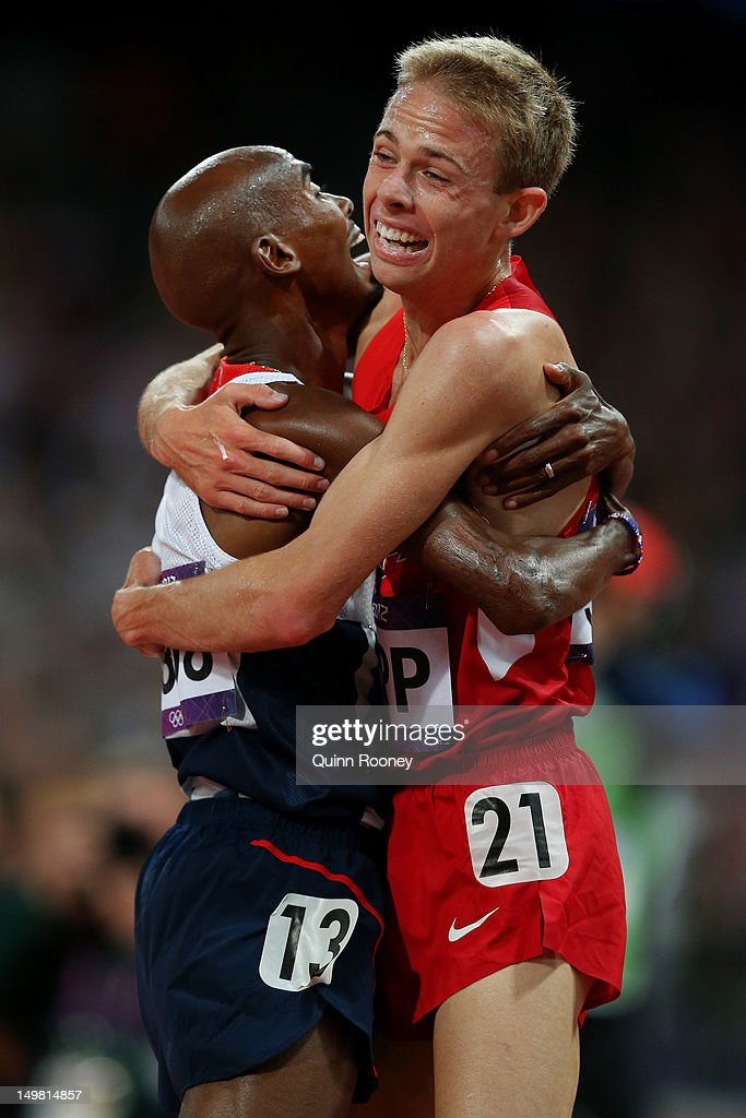 Mohamed Farah of Great Britain celebrates winning the gold medal in Men's 10,000m Final with Galen Rupp of the United States on Day 8 of the London 2012 Olympic Games at Olympic Stadium on August 4, 2012 in London, England.