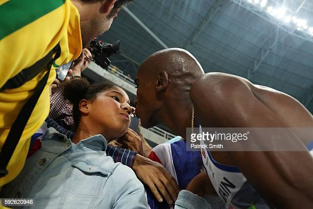 Mohamed Farah of Great Britain celebrates with daughter Rihanna after winning gold in the Men's 5000 meter Final on Day 15 of the Rio 2016 Olympic...