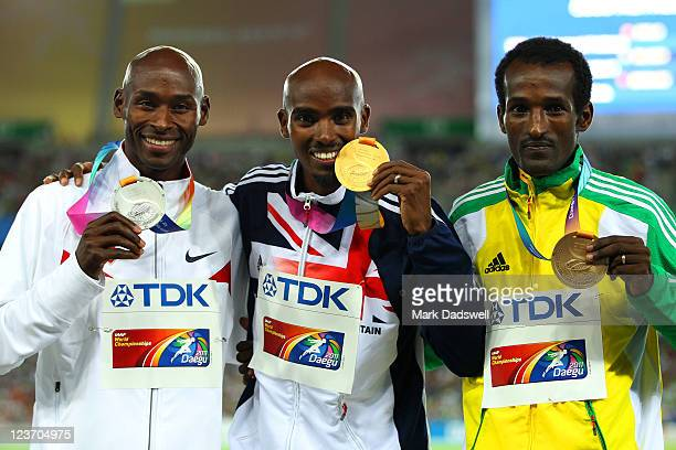 Mohamed Farah of Great Britain celebrates with his gold medal Bernard Lagat of the USA the silver and Dejen Gebremeskel of Ethiopia the bronze during...