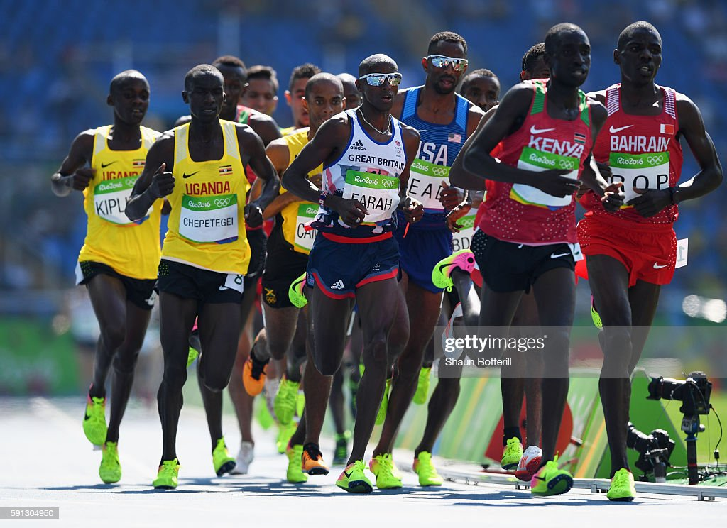 Mohamed Farah of Great Britain (C) competes in the Men's 5000m Round 1 on Day 12 of the Rio 2016 Olympic Games at the Olympic Stadium on August 17, 2016 in Rio de Janeiro, Brazil.
