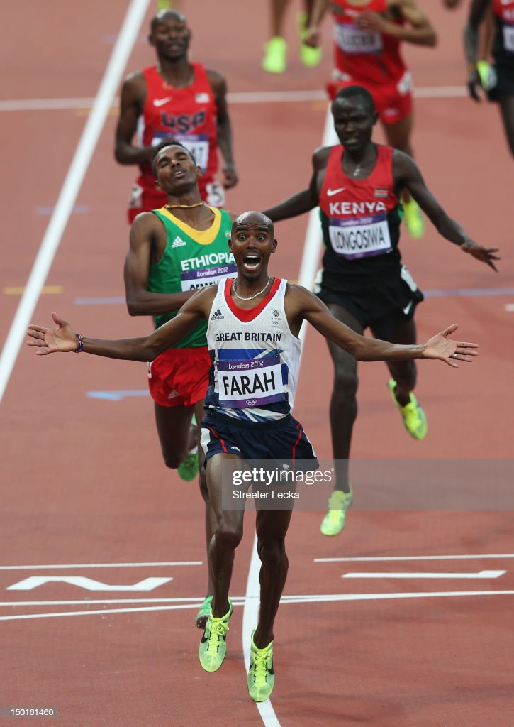 Mohamed Farah of Great Britain crosses the finish line to win gold ahead of Dejen Gebremeskel of Ethiopia and Thomas Pkemei Longosiwa of Kenya in the Men's 5000m Final on Day 15 of the London 2012 Olympic Games at Olympic Stadium on August 11, 2012 in London, England.