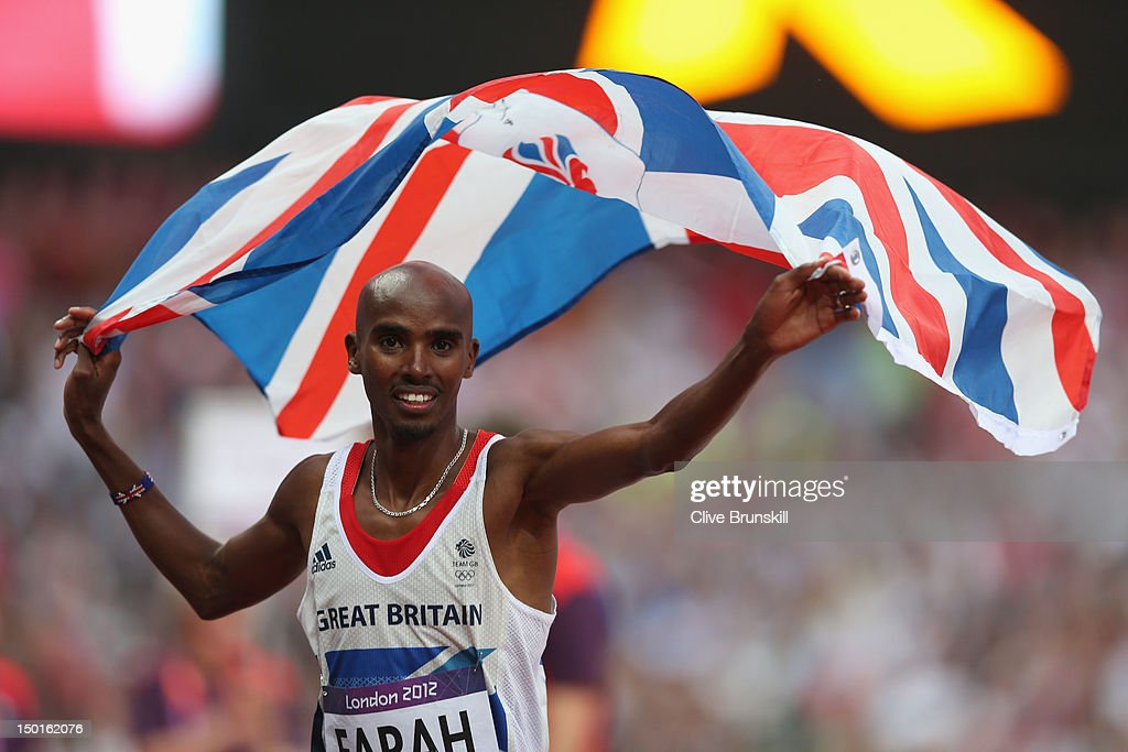 Mohamed Farah of Great Britain holds a union jack aloft as he celebrates winning gold in the Men's 5000m Final on Day 15 of the London 2012 Olympic Games at Olympic Stadium on August 11, 2012 in London, England.