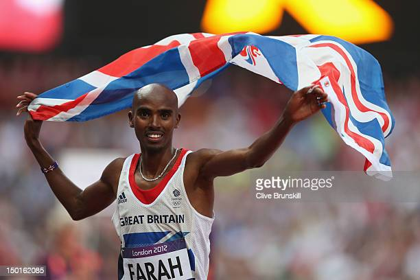 Mohamed Farah of Great Britain holds a union jack aloft as he celebrates winning gold in the Men's 5000m Final on Day 15 of the London 2012 Olympic...