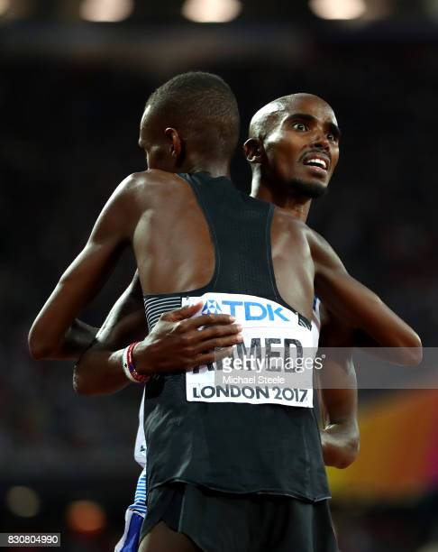 Mohamed Farah of Great Britain hugs Mohammed Ahmed of Canada after the Men's 5000 Metres final during day nine of the 16th IAAF World Athletics...