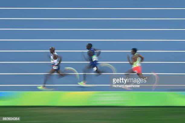 Mohamed Farah of Great Britain leads the field during the Men's 5000 meter Final on Day 15 of the Rio 2016 Olympic Games at the Olympic Stadium on...