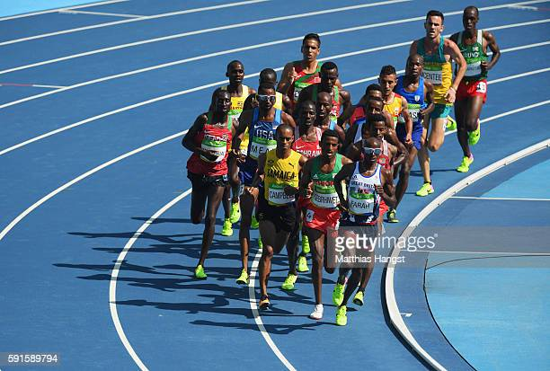 Mohamed Farah of Great Britain leads the pack during the Men's 5000m Round 1 on Day 12 of the Rio 2016 Olympic Games at the Olympic Stadium on August...