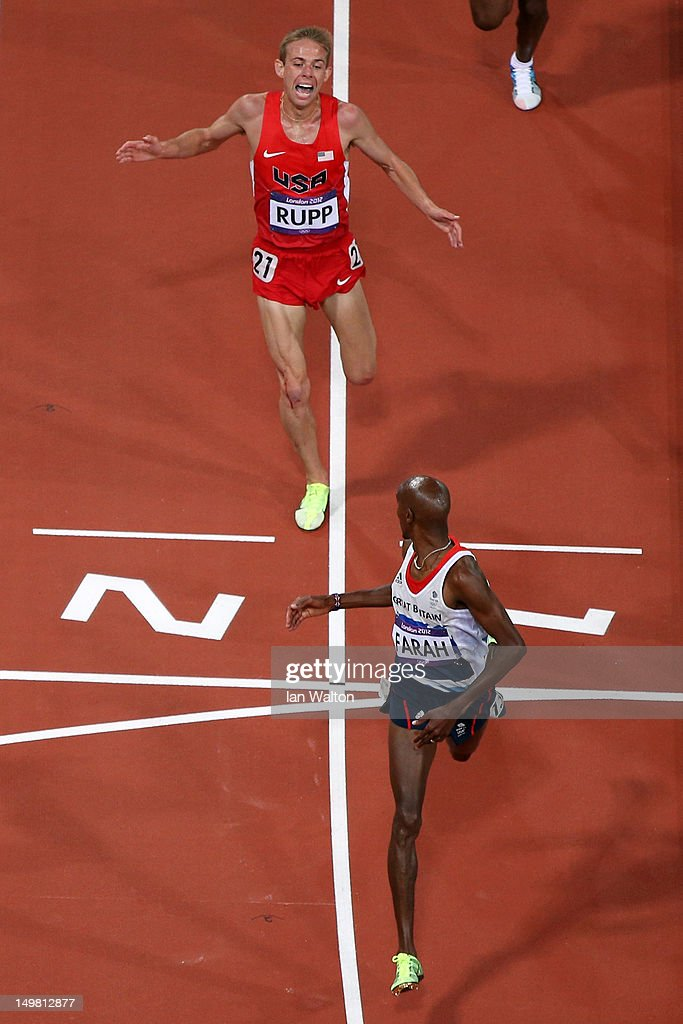 Mohamed Farah of Great Britain looks back to Galen Rupp of the United States as he crosses the line to win gold in the Men's 10,000m Final on Day 8 of the London 2012 Olympic Games at Olympic Stadium on August 4, 2012 in London, England.