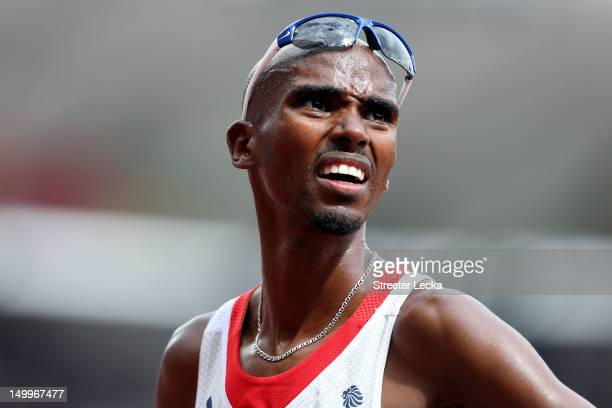 Mohamed Farah of Great Britain looks on after competing in the Men's 5000m Round 1 Heats on Day 12 of the London 2012 Olympic Games at Olympic...