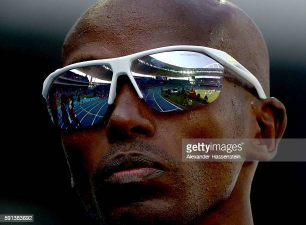 Mohamed Farah of Great Britain looks on prior to the Men's 5000m Round 1 on Day 12 of the Rio 2016 Olympic Games at the Olympic Stadium on August 17...