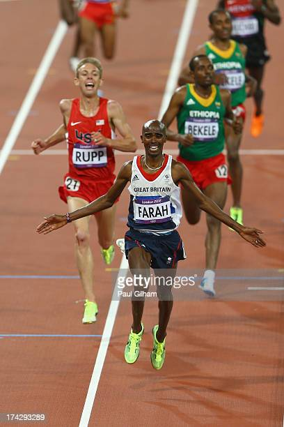 Mohamed Farah of Great Britain raises his arms as he crosses the line to win the Men's 10 000 metres final on Day 8 of the London 2012 Olympic Games...