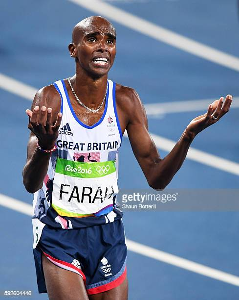 Mohamed Farah of Great Britain reacts after winning gold during the Men's 5000 meter Final on Day 15 of the Rio 2016 Olympic Games at the Olympic...