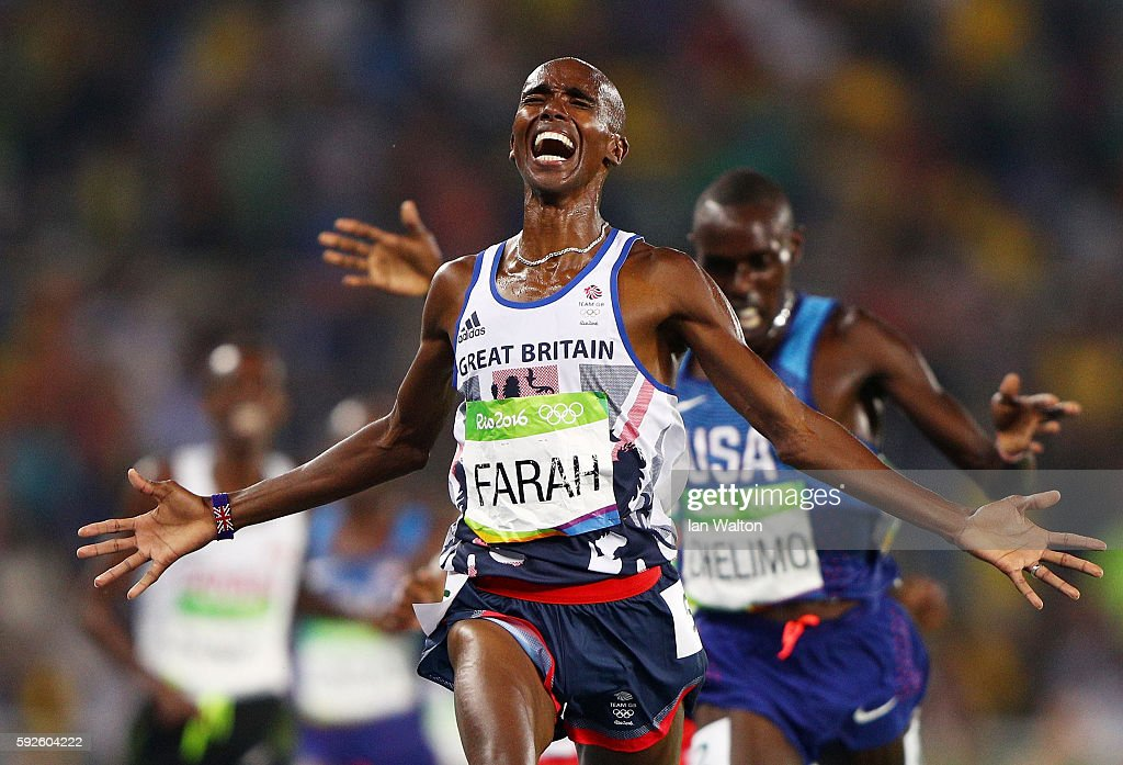 Mohamed Farah of Great Britain reacts after winning gold in front of Paul Kipkemoi Chelimo of the United States in the Men's 5000 meter on Day 15 of the Rio 2016 Olympic Games at the Olympic Stadium on August 20, 2016 in Rio de Janeiro, Brazil.