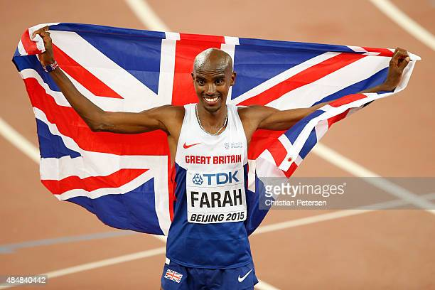 Mohamed Farah of Great Britain reacts after winning gold in the Men's 10000 metres final during day one of the 15th IAAF World Athletics...