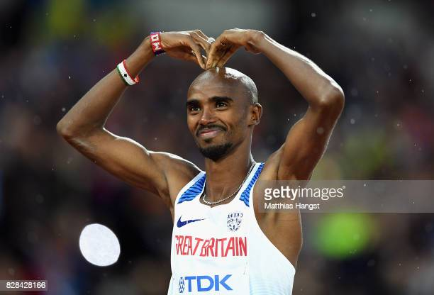 Mohamed Farah of Great Britain reacts by doing the mobot as he celebrates after competing in the Men's 5000 Metres heats during day six of the 16th...