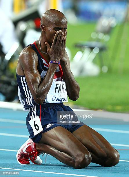 Mohamed Farah of Great Britain shows his dejection after losing the lead in and finishing second in the men's 10000 metres final during day two of...