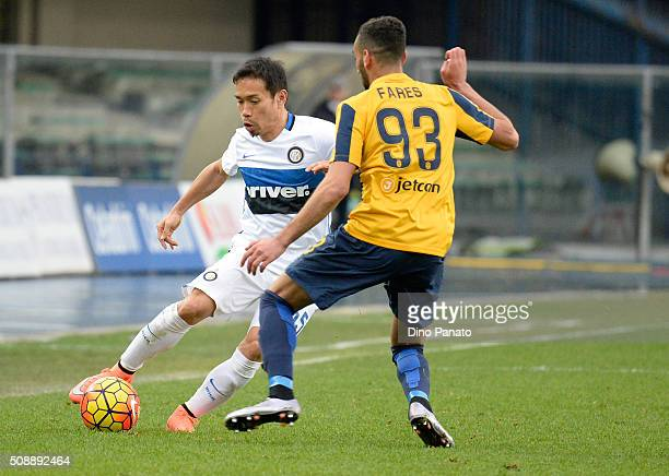 Mohamed Fares of Hellas Verona competes with Yuto Nagatomo of during the Serie A match between Hellas Verona FC and FC Internazionale Milano at...