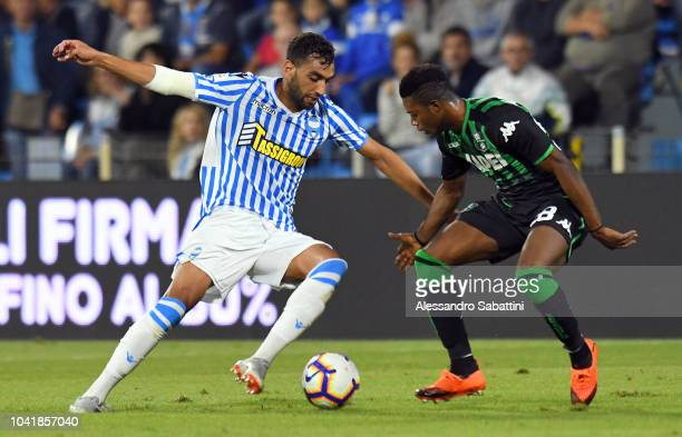 Mohamed Fares of Spal competes for the ball with Claud Adjapong of Sassuolo during the serie A match between SPAL and US Sassuolo at Stadio Paolo...