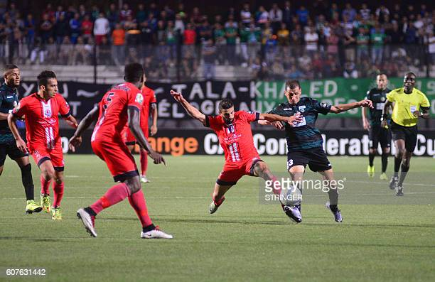 Mohamed Fouzair of FUS RabatSofiane Baouali of MO Bejaia go headtohead in the first leg of the 2016 Caf Confederation Cup semifinal at the Stade de...